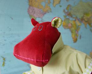 stuffed hippo doll in dress and rain coat